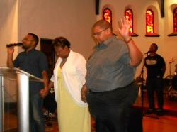 Local clergy pray and call for peace following the murders (photo by Brian Bull)