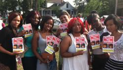 East Cleveland residents hold up flyers of Shirellda Terry at a Friday vigil at 146th & St. Clair (photo by Brian Bull)