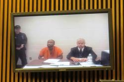Michael Madison is arraigned via video link in the Cuyahoga County Court of Common Pleas.