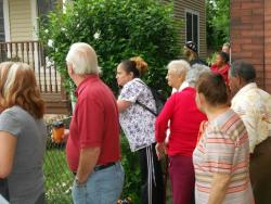 Local residents and other curiosity seekers gathered outside the police tape to watch (pic by Brian Bull)
