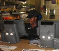 Wynn works the cash register at a Cleveland-area Mexican fast-food restaurant chain (pic by Brian Bull)