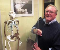 Researcher Bruce Latimer, next to the Cleveland Museum of Natural History's older Lucy skeleton (pic by Brian Bull)