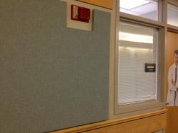 A blue, cloth sound panel helps absorb the noise in Lerner Towers.