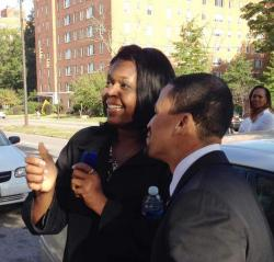 Gary Norton and Joy Jordan share a moment of levity at a press event announcing the demolition of abandoned buildings.