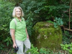 Ellen Marsh of the Friends of the Crooked River, near an old sewer fixture in Akron (pic by Brian Bull)