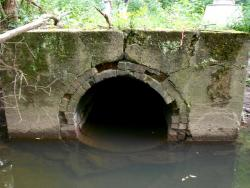 An old 1930s-era tunnel empties out near the Little Cuyahoga in Akron (pic by Brian Bull)