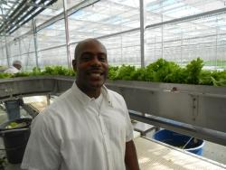 Brushawn Fletcher at his job at Green City Growers.  He also works at Metal Fabrication Inc. (pic by Brian Bull)