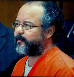 Ariel Castro shown on a video screen at a court hearing. (Brian Bull / ideastream)