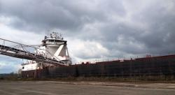 A ship unloads limestone at the port facility on Whiskey Island. (Nick Castele / ideastream)