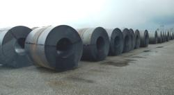 Rolls of steel wait to be loaded onto trains at the port. (Nick Castele / ideastream)