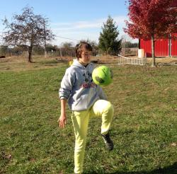Sophia Dean kicks the soccer ball around her front yard. (Photo by Amy Hansen)