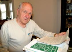 Phil Franz looks over decades of legal paperwork (photo: DCB)
