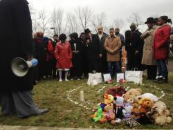 East Cleveland pastors, Mayor Gary Norton and others stand last December at the site of the fatal police shooting.