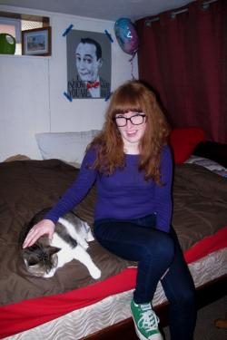 Gibbons and her cat, Bandit, in her basement room (pic by Brian Bull)