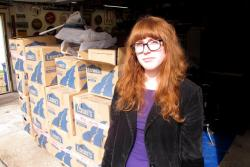 Bridget Gibbons with her possessions, currently stashed in her parents' garage (pic by Brian Bull)