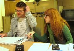 Gibbons helps a student at Cuyahoga Community College with his studies (pic by Brian Bull)
