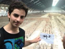 Adam Yaseen gives a shout out to 90.3 while visiting the famed Terracotta Army in China