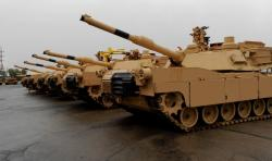A row of finished M1A1 Abrams tanks outside the JSMC in Lima, Ohio (pic by Brian Bull)