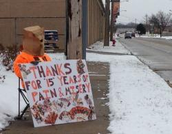 Browns fan Jeff Mazie sits across the street from the team's training facility. (Nick Castele / ideastream)