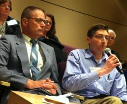 Paul Gothard, left, and his University Hospitals oncologist Dr. Judah Friedman speaking at the June day-long symposium