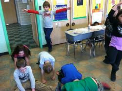 Second-graders at Brookridge Elementary take a quick break for yoga.