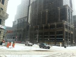 Traffic crawls through downtown Cleveland this afternoon, with sideways snow obscuring visibility (pic by Brian Bull)