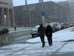 A Cleveland couple navigates the windy, cold streets near the downtown area (pic by Brian Bull)