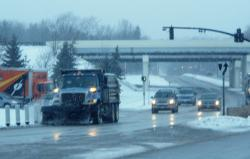 A snow plow works the roads in Solon, near the 422 and 91 intersection (photo by ideastream's Brian Bull)