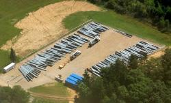 Aerial view shows pipes at shale rig development site (photo by Ted Auch PhD, FracTracker, June 2013)