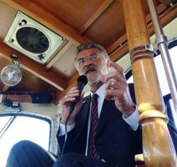 Cleveland Mayor Frank Jackson gives reporters a trolley tour of Cleveland during his 2013 reelection campaign.