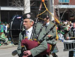 A piper makes his way down Superior Avenue (pic by Brian Bull)