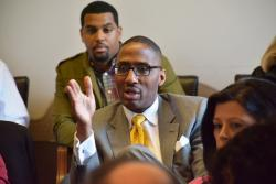 Cleveland City Councilman Zack Reed asks FitzGerald if he supports redistricting reform. (Nick Castele / ideastream)