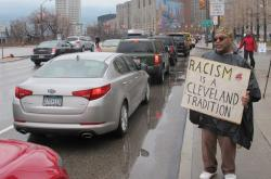 Demonstrator Zizwe Tchiguka rallies against the Chief Wahoo mascot (pic by Brian Bull)