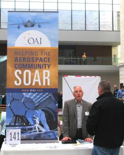 A reprsentative describes his company's potential for the aeronautics industry to a visitor (pic by Brian Bull)