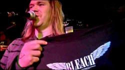 Bleach vocalist Dusty Holt displays some band merchandise.