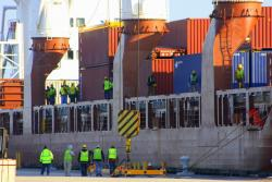 Dozens of port workers prepare to unload the Fortunagracht Saturday morning (pic: Brian Bull)