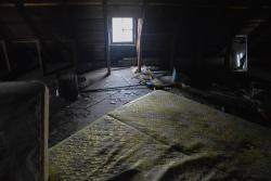 The attic of an abandoned house in Cleveland's Cudell neighborhood. (Nick Castele / ideastream)
