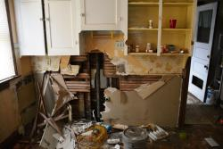 The kitchen of an abandoned house in Cleveland's Cudell neighborhood. (Nick Castele / ideastream)