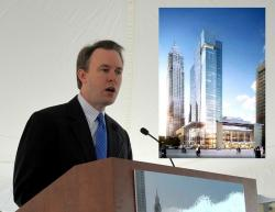 FitzGerald and an architectural rendering of the soon-to-be-completed Hilton Hotel (pic: Brian Bull)