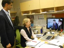 Baiju Shah and Joy Roller, of Global Cleveland, discuss one of their promotional videos. Photo by Joanna Richards