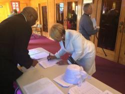 Voter registration forms and a petition sit in the foyer of Mt. Olive church. (Tony Ganzer/WCPN)