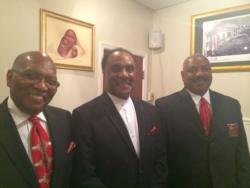 Pastor Larry Harris and church staff (center) (Tony Ganzer/WCPN)