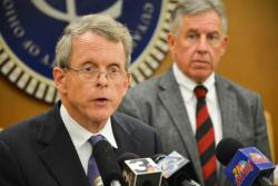 Ohio Attorney General Mike DeWine speaks with reporters at an unrelated press conference in May. (Nick Castele)
