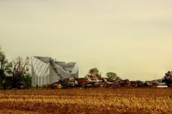 Firefighters take stock of a damaged farm building in Cedarville after a reported tornado. (Photo: Barb Sloan)