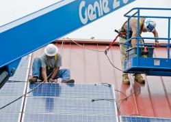 Workers install solar panels in Ohio. (Wayne National Forest on Flickr https://www.flickr.com/photos/waynenf/3725848206)
