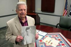 Matthew Heba, Cleveland native and U.S. Navy veteran, with a portait of himself during World War II (pic by Brian Bull)