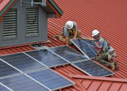 Workers install solar panels in Ohio. (Wayne National Forest on Flickr https://www.flickr.com/photos/waynenf/3725860708)