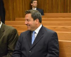 Mahoning County Auditor Michael Sciortino awaits his arraignment in Cuyahoga County court. (Nick Castele / ideastream)