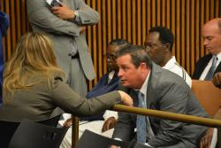 Former candidate for prosecutor Martin Yavorcik talks with his attorney, Jennifer Scott. (Nick Castele / ideastream)