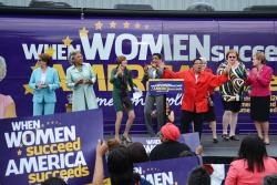 Reps. Pelosi, Beatty, DeLauro, Edwards, Fudge and Kaptur dance and greet supporters. (Nick Castele / ideastream)